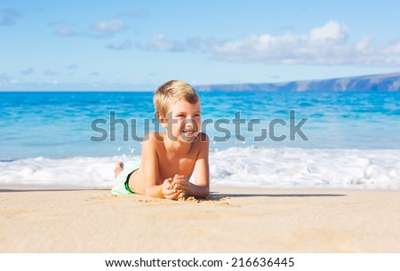 Happy Young Boy on the Beach - stock photo