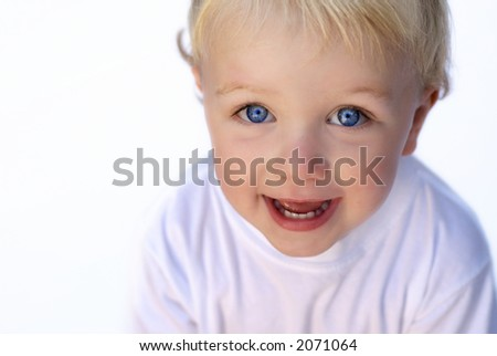 Happy young boy on white background - stock photo