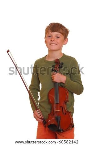 Happy young boy shows his violin - stock photo