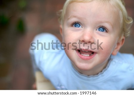 Happy young boy smiling - stock photo