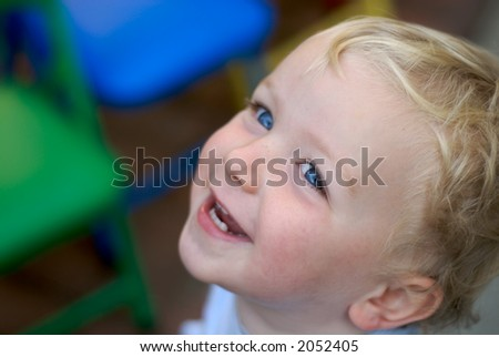 Happy young boy with big smile - stock photo