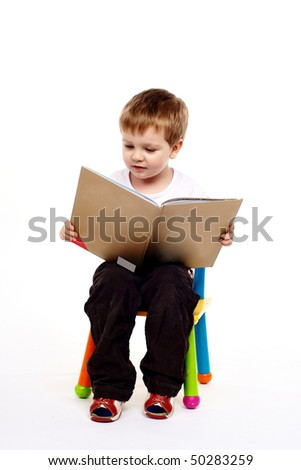 Happy young boy with book - stock photo