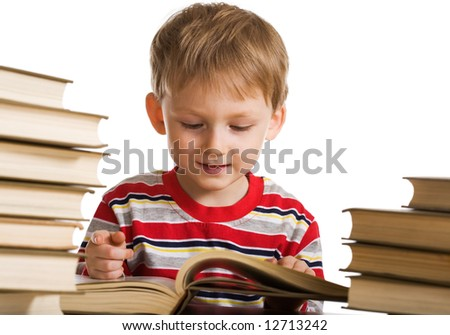 Happy young boy with books