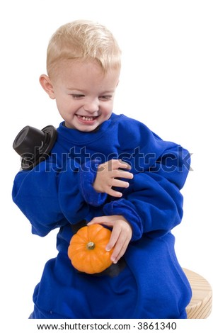 Happy young boy with costume with a pumpkin