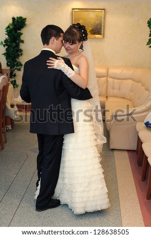 Happy young bride and groom on their wedding day. Wedding couple - new family! wedding dress. Bridal wedding bouquet of flowers - stock photo
