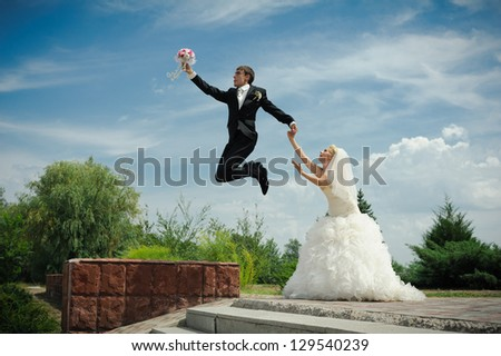 Happy young bride and groom outside on their wedding day - Copyspace. Wedding couple - new family! wedding dress. Bridal wedding bouquet of flowers - stock photo