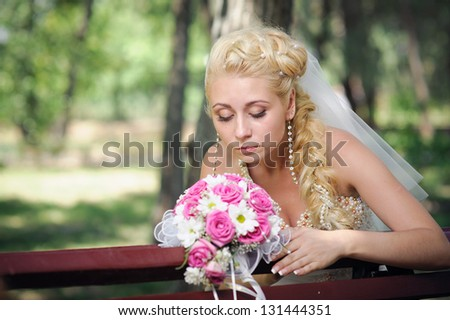 Happy young bride outside on her wedding day - Copyspace. Wedding couple - new family! wedding dress. Bridal wedding bouquet of flowers