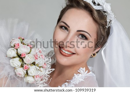 Happy young bride with wedding bouquet - stock photo