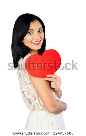 Happy young brunette with red Valentine heart isolated on white background - stock photo