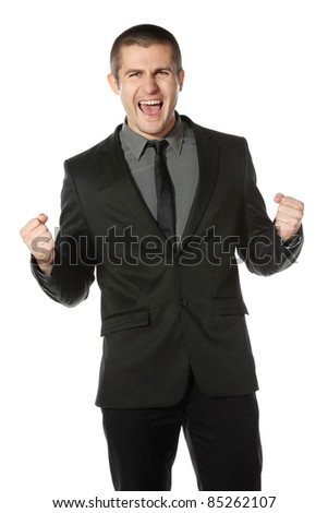 Happy young business man celebrating success over white background