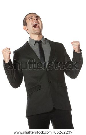 Happy young business man celebrating success shouting upwards, over white background - stock photo