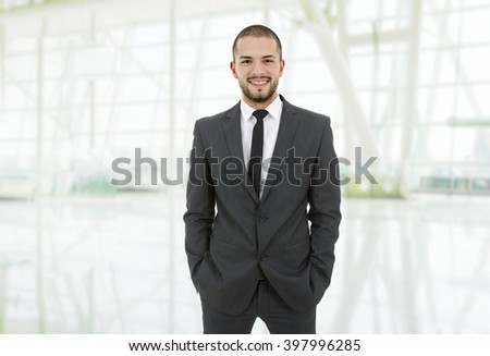 happy young business man portrait at the office - stock photo