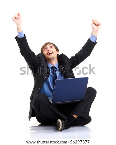Happy young business man working on a laptop, isolated against white background - stock photo