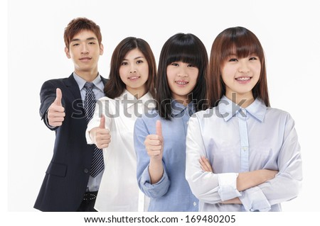 Happy young business partners looking at camera with smiles and showing sign of okay - stock photo