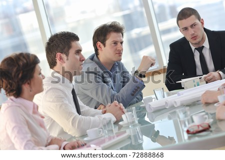 happy young business people group have  meeting at conference room and argue about new ideas and plans - stock photo