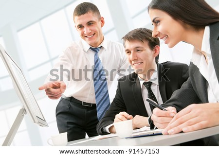 Happy young business people working together - stock photo