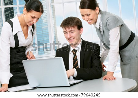 Happy young business people working together in a modern office building