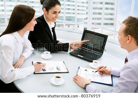 Happy young business people working together in a modern office building - stock photo
