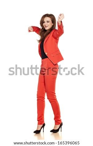 happy young business woman dancing on white background - stock photo