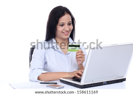 Happy young business woman doing on line shopping against white - stock photo
