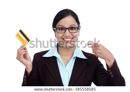 Happy young business woman holding credit card against white background