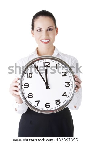 Happy young business woman holding office clock, isolated on white background - stock photo