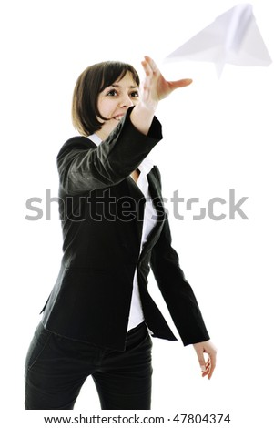 happy young business woman isolated ona white throwing paper airplane - stock photo
