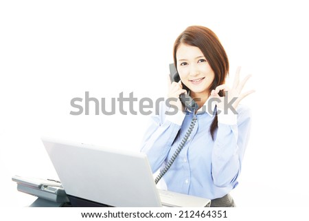 Happy young business woman making ok sign