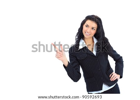 happy young business woman pointing at something interesting against white background - stock photo