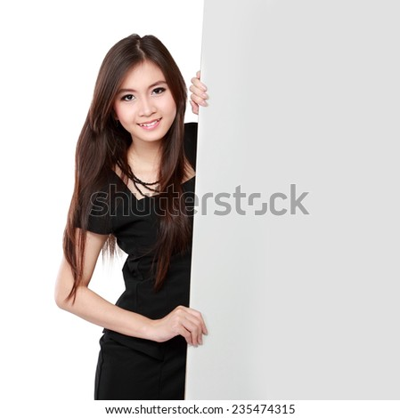 Happy young business woman showing blank signboard, isolated on white background - stock photo