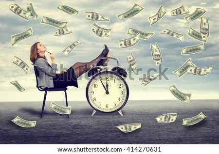 Happy young business woman sitting on a chair under a money rain . - stock photo
