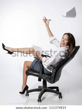 Happy young business woman sitting on chair against white background