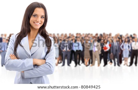 Happy young business woman standing in front of her team - stock photo