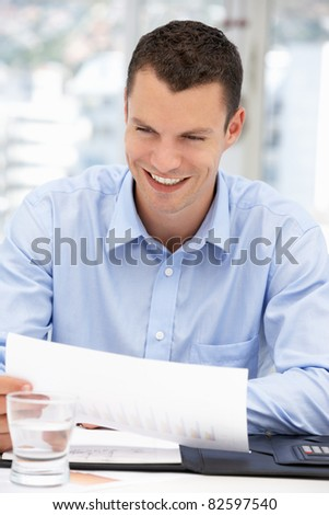 Happy young businessman - stock photo
