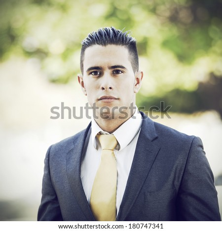 Happy young businessman at the city park - stock photo