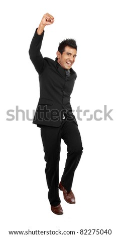 happy young businessman celebrating success - stock photo