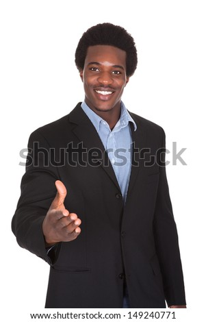 Happy Young Businessman Extending Hand To Shake