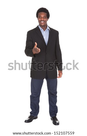 Happy Young Businessman Extending Hand To Shake - stock photo