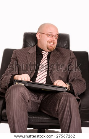 Happy young businessman holding laptop