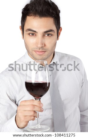 Happy young businessman holding red wine glass isolated on white background. - stock photo