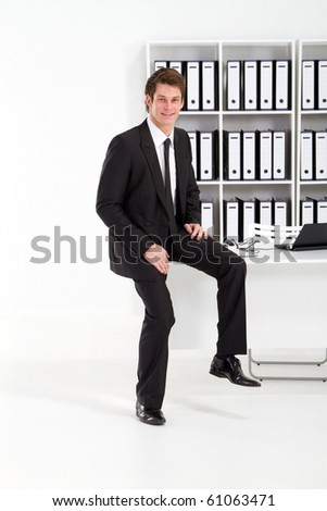 happy young businessman in office - stock photo