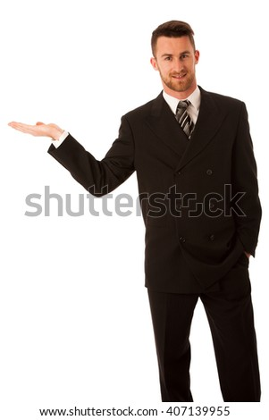 Happy young businessman in suit and tie presenting, promoting, advertising isolated over white.