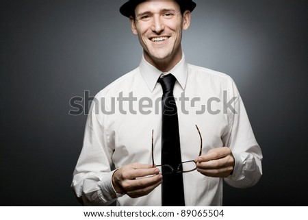 Happy young  businessman in white shirt and black hat. - stock photo