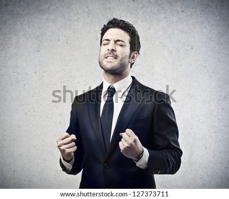 happy young businessman of his success - stock photo