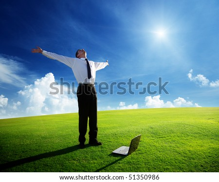 happy young businessman on spring field - stock photo