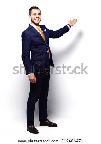 Happy Young Businessman Presenting Isolated Over White Background - stock photo