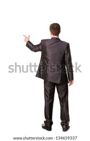 Happy young businessman's back pointing finger at emoty space for your text isolated on white