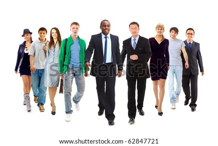 Happy young businessman standing in front of her team
