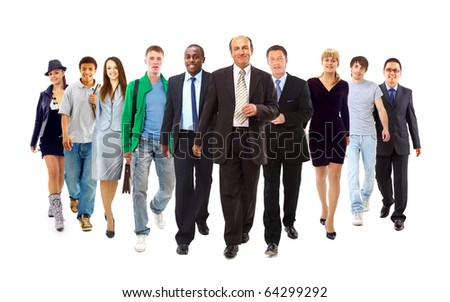 Happy young businessman standing in front of her team - stock photo