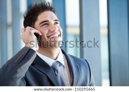 happy young businessman talking on the mobile phone - stock photo